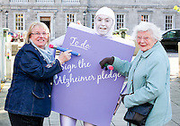 NO REPRO FEE. 18/10/2011. Cross partyTDs  to put aside party differences for Alzheimers. Cross party elected officials will join forces with a giant purple post it character outside the gates of Dail Eireann to remind elected officials to sign up to the Alzheimer Pledge to bring in a National Dementia Strategy for Ireland. Pictured are careers Marilyn Sheehan from Limerick and Muriel Banks from Dublin. Picture James Horan/Collins Photos