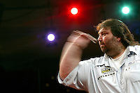 08 January, 2004: ANDY FORDHAM throws a dart during his quarter final victory over Fitton,Fordham beat Fitton 5-4,  World Professional Darts Championships, Lakeside Country Club, Frimley Green, Surrey,  Photo: Glyn Kirk/Action Plus...throw throws player 040111