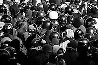 A group of black bolc militants disguise themselves in to the crowd during the national rally of 15 Oct.. 2011. Rome, Italy