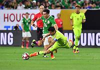 Mexico midfielder Hector Herrera (16) fouled Venezuela midfielder Tomas Rincon (8) during Copa America Centenario group C match, Monday, June 13, 2016 in Houston, Tex. Mexico draw Venezuela 1-1.(TFV Media via AP) *Mandatory Credit*