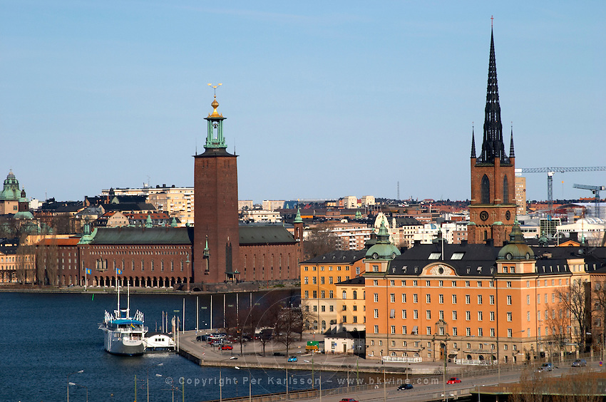 View to Stadshuset, the City Hall, over the Riddarfjarden, with its iconic tower with three crowns. From Slussen, seen over the Central Bridge Centralbron and Riddarholmen. Kungsholmen Stockholm. Sweden, Europe.