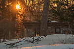 The rising sun illuminates a stone cabin in northern Wisconsin.