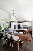 open plan kitchen and wooden dining table