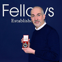 BNPS.co.uk (01202) 558833. <br /> Pic: FellowsAuctioneers/BNPS<br /> <br /> With Video - https://we.tl/t-b8hueJpc4M<br /> <br /> Pictured: Steven Yambo with the stopwatch. <br /> <br /> A stopwatch used by English football referee Jack Taylor to time the 1974 World Cup final is going under the hammer.<br /> <br /> The piece of football history assisted Taylor when awarding two penalties in the first 30 minutes of the match – including the fastest ever given in a World Cup final.<br /> <br /> The Omega watch is being sold by Taylor's family for an estimated £5,000 at auctioneers Fellows of Birmingham.