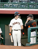 Buster Posey / AZL Giants going over the signs with manager Dave Machmer at Scottsdale Stadium in his professional debut - 08/22/2008..Photo by:  Bill Mitchell/Four Seam Images