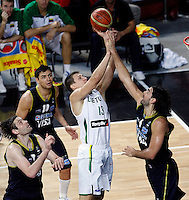 Paulius JANKUNAS (Lithuania) shoots over Luis SCOLA (Argentina), Fabricio OBERTO (Argentina) left and Carlos DELFINO (Argentina)  during the quarter-final World championship basketball match against Argentina in Istanbul, Lithuania-Argentina, Turkey on Thursday, Sep. 09, 2010. (Novak Djurovic/Starsportphoto.com).