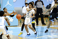 CHAPEL HILL, NC - FEBRUARY 24: RJ Davis #4 of North Carolina passes the ball during a game between Marquette and North Carolina at Dean E. Smith Center on February 24, 2021 in Chapel Hill, North Carolina.
