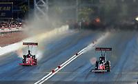 Apr. 13, 2008; Las Vegas, NV, USA: NHRA top fuel dragster driver Cory McClenathan (right) defeats Brandon Bernstein in the semi finals during the SummitRacing.com Nationals at The Strip in Las Vegas. Mandatory Credit: Mark J. Rebilas-