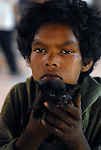 Boy with kitten in the Paharganj district of New Delhi, India.
