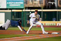 Bradenton Marauders first baseman Will Matthiessen (10) catches a pickoff attempt throw as Wenceel Perez (1) dives back to the bag during a game against the Lakeland Flying Tigers on May 18, 2021 at LECOM Park in Bradenton, Florida.  (Mike Janes/Four Seam Images)