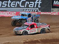 Mar. 20, 2011; Chandler, AZ, USA;  LOORRS pro two driver Rodrigo Ampudia (36) leads Robby Woods (99) during round two at Firebird International Raceway. Mandatory Credit: Mark J. Rebilas-