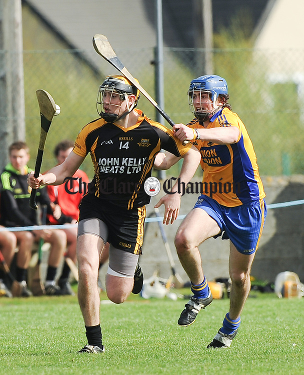 Niall Deasy of Ballyea in action against Alex Morey of Sixmilebridge during the U-21 championship final at Clarecastle. Photograph by John Kelly