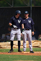 FCL Yankees Trey Sweeney (33) talks with manager Tyson Blaser (50) during a game against the FCL Tigers West on July 31, 2021 at Tigertown in Lakeland, Florida.  (Mike Janes/Four Seam Images)