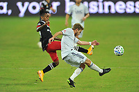 WASHINGTON, DC - SEPTEMBER 27: Scott Caldwell #6 of New England Revolution battles for the ball with Yordi Reyna #29 of D.C. United during a game between New England Revolution and D.C. United at Audi Field on September 27, 2020 in Washington, DC.