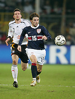 Germany's Arne Friedrich closes in on USA's Bobby Convey at Signal Iduna Park, Dortmund, Germany, March 22, 2006. Germany won 4-1.