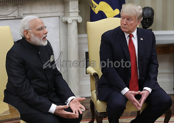 United States President Donald Trump (R) meets with Indian Prime Minister Narendra Modi (L) in the Oval Office of the White House June 26, 2017 in Washington, DC. Trump and Modi are scheduled to deliver joint statements later today following their meetings. Photo Credit: Win McNamee/CNP/AdMedia