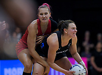 England's George Fisher pressures NZ's Claire Kersten during the Cadbury Netball Series Taini Jamison Trophy match between New Zealand Silver Ferns and England Roses at Claudelands Arena in Hamilton, New Zealand on Wednesday, 28 October 2020. Photo: Dave Lintott / lintottphoto.co.nz