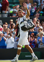 01-07-13, England, London,  AELTC, Wimbledon, Tennis, Wimbledon 2013, Day seven, Juan Martin Del Potro (ARG)<br /> waves to the public when he leaves the court<br /> <br /> <br /> <br /> Photo: Henk Koster