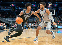 WASHINGTON, DC - FEBRUARY 19: David Duke #3 of Providence moves past Jagan Mosely #4 of Georgetown during a game between Providence and Georgetown at Capital One Arena on February 19, 2020 in Washington, DC.