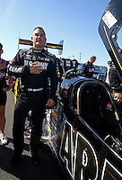 Mar 15, 2015; Gainesville, FL, USA; NHRA top fuel driver Tony Schumacher during the playing of the National Anthem at the Gatornationals at Auto Plus Raceway at Gainesville. Mandatory Credit: Mark J. Rebilas-