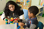 Education Preschool 3-4 year olds therapist working with boy in classroom