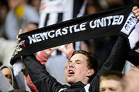 14.03.2013 Newcastle, England. Newcastle fans go wild after a last minute} goal sees them through to the last eight in action during the Europa League game between Newcastle and Anzhi Makhachkala from St James Park.