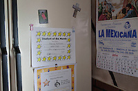 Student of the month certificate on the fridge at Esperanza Pacheco's home in Painesville , Ohio. Her daughters Maricza and Mirka Moctezuma both had certificates posted to the family fridge. Painesville, Ohio. Photo by Brendan Bannon. March 25, 2014.