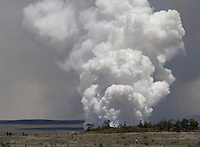 Halema'uma'u crater with rising volcanic ash cloud at Hawai'i Volcanoes National Park, Big Island of Hawai'i.