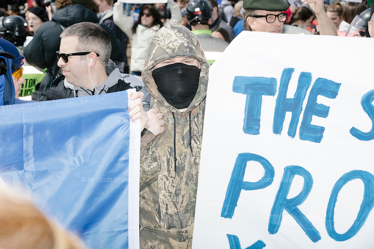 Pro-gun demonstrators antagonize the much larger crowd surrounding them in Boston Common during the March For Our Lives protest and demonstration in Boston, Massachusetts, USA, on Sat., March 24, 2018, in response to recent school gun violence.