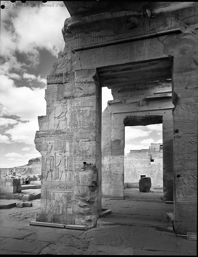 """""""Temple's Edge""""<br /> Temple of Philae<br /> Agilika Island, Egypt<br />  2011<br /> <br /> Ancient worshippers made pilgrimages to the island of Philae to pay tribute to Isis.  Isis was said to watch over one of the mythical burial places of her husband Osiris.  Temple walls show hieroglyphs depicting tributes made to Isis, Hathor, and Osiris.<br /> <br /> <br /> 4 x 5 Large Format Film"""