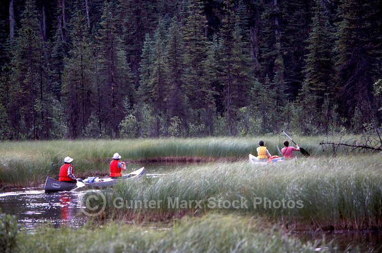 Canoeing at the Start of the Bowron Lakes Canoe Circuit in Bowron Lake Provincial Park, in the Cariboo Region of British Columbia, Canada, in Summer