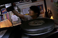 """Richard J. Concepcion, aka Rapid T. Rabbit, searches for a tape in his apartment among the 23-year archive of his cable access television show """"Rapid T. Rabbit and Friends.""""   Furries are a group of people who identify themselves not as being human but as a walking, talking animal.  For some the lifestyle is complete, animal traits reach into every aspect of life from mundane trips to a grocery store to sexual fantasies.  For others, involvement in the furry fandom is limited to public performances and meet-and-greets."""