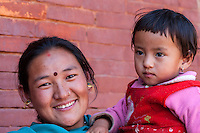 Nepal, Patan.  Nepali Mother and Daughter.  The mother wears a bindi between her eyes, and a nose-ring.