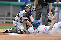 Jackson Generals catcher Marcus Littlewood (4) tags out a hard sliding Billy McKinney (4) during a game against the Tennessee Smokies at Smokies Stadium on July 5, 2016 in Kodak, Tennessee. The Generals defeated the Smokies 6-4. (Tony Farlow/Four Seam Images)