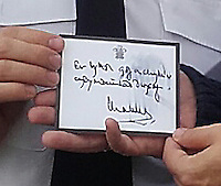 """Pictured: The card left by HRH Prince Charles in Aberfan<br /> A card writen by HRH Prince Charles and left at the Aberfan Cemetery which went missing, has been returned in an anonymous package and given back to the community.<br /> South Wales Police Chief Inspector Marc Lamerton said: """"We are grateful that whoever took this realised the distress it was causing to the community of Aberfan and have seen the error of their ways and returned it to its rightful owners."""""""