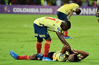 BUCARAMANGA - COLOMBIA, 09-02-2020: Johan Carbonero y Jaime Alvarado de Colombia lucen decepcionados después del partido entre Colombia U-23 y Uruguay U-23 por el cuadrangular final como parte del torneo CONMEBOL Preolímpico Colombia 2020 jugado en el estadio Alfonso Lopez en Bucaramanga, Colombia. / Johan Carbonero and Jaime Alvarado of Colombia look disappointed after the match between Colombia U-23 and Uruguay U-23 of for the final quadrangular as part of CONMEBOL Pre-Olympic Tournament Colombia 2020 played at Alfonso Lopez stadium in Bucaramanga, Colombia. Photo: VizzorImage / Julian Medina / Cont
