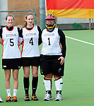 FRANKFURT AM MAIN, GERMANY - April 14: (L-R) Henrike Voigt #5, Jella Kandziora #4 and Sabine Paul #1 of Germany during the national anthem before the Deutschland Lacrosse International Tournament match between Germany vs Great Britain during the on April 14, 2013 in Frankfurt am Main, Germany. Great Britain won, 10-9. (Photo by Dirk Markgraf)