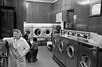 Laundrette families use commercial laundry as they have no facilities to clothes wash at home 1970s London UK