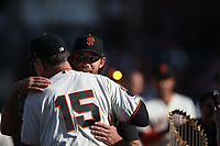 SAN FRANCISCO, CA - SEPTEMBER 29:  Madison Bumgarner #40 of the San Francisco Giants hugs manager Bruce Bochy during a ceremony celebrating the career of Bochy after the game between the Los Angeles Dodgers and the San Francisco Giants at Oracle Park on Sunday, September 29, 2019 in San Francisco, California. (Photo by Brad Mangin)