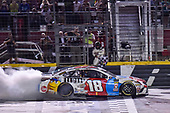 #18: Kyle Busch, Joe Gibbs Racing, Toyota Camry M&M's Red White & Blue, does a burnout after winning