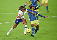 ORLANDO, FL - JANUARY 18: Catarina Macario #29 of the United States battles for a loose ball during a game between Colombia and USWNT at Exploria Stadium on January 18, 2021 in Orlando, Florida.