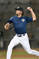 Pitcher Taylor Henry (22) of the Columbia Fireflies delivers a pitch in a game against the Charleston RiverDogs on Monday, August 27, 2018, at Spirit Communications Park in Columbia, South Carolina. Charleston won, 4-0. (Tom Priddy/Four Seam Images)