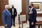 Palestinian President Mahmoud Abbas meets with British Foreign Secretary Dominic Raab in the West Bank city of Ramallah, on August 25, 2020. Photo by Thaer Ganaim