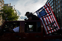 A man carries a Black Lives Matter flag while standing inside a Jeep during a march against police brutality and racism in Washington, D.C. on Saturday, June 6, 2020.<br /> Credit: Amanda Andrade-Rhoades / CNP/AdMedia