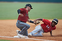 Devin Obee (54) of Ensworth HS in Nashville, TN playing for the Cincinnati Reds scout team slides into third base as Cole Messina (25) of Summerville HS in Summerville, SC playing for the Arizona Diamondbacks scout team prepares to apply a tag during the East Coast Pro Showcase at the Hoover Met Complex on August 4, 2020 in Hoover, AL. (Brian Westerholt/Four Seam Images)