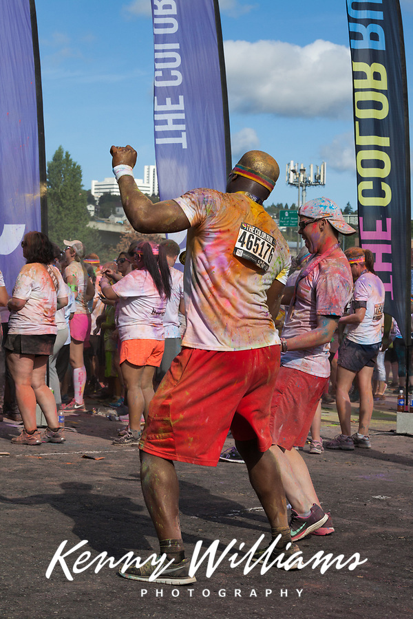 Man dancing at The Color Run 2015, Tacoma, Washington State, WA, America, USA.