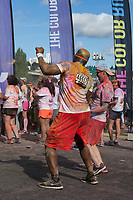 Man dancing at The Color Run 2015, Tacoma, Washington State, WA, America, USA.