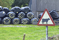 Big bale silage with smiley faces near Hawes, North Yorkshire.