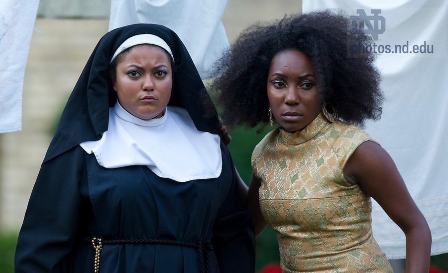 """Aug, 26, 2013; Actors from the Young Company, Jackie Gessert and Zuri Eshun perform in Shakespeare's """" The Comedy of Errors"""" in the Main Building Quad (in front of the Golden Dome). Photo by Barbara Johnston/University of Notre Dame"""