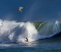 Surfer under watchful eyes of the HFD during one of the most memorable South swells of 2011.